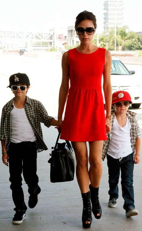 Red dress, up-do, large sun glasses, Victoria beckham outfit
