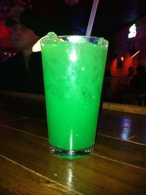 Liquid Marijuana - Seriously, my favorite drink EVERR!!! Equal Parts - Captain Morgan, Blue Caracao, Midori, Malibu Coconut, and then remainder pineapple juice.