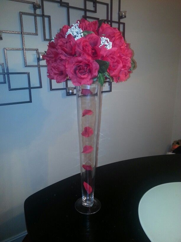 Red Rose Centerpiece With Trumpet Vase And Falling Rose Petals Centerpiece Roses Event Decor Event Centerpieces Decor Pinterest Vase