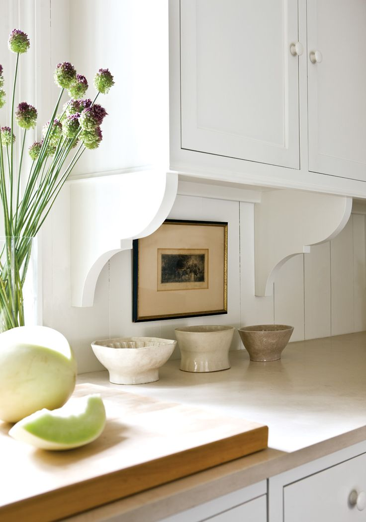 charming brackets & travertine, ironstone molds (which could be lovely nibble dishes for parties).