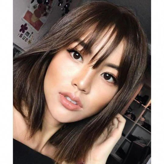 Wispy Bangs | With thin hair, you don't want to commit to straight-across bangs that will fall flat. Instead, opt for wispy, textured fringe. #mediu...