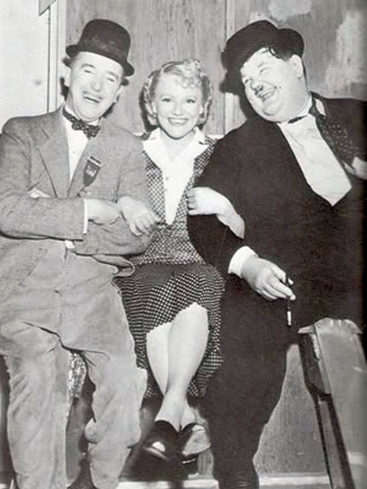 Minna Gombell visits the boys on the 'Blockheads' set. 1938