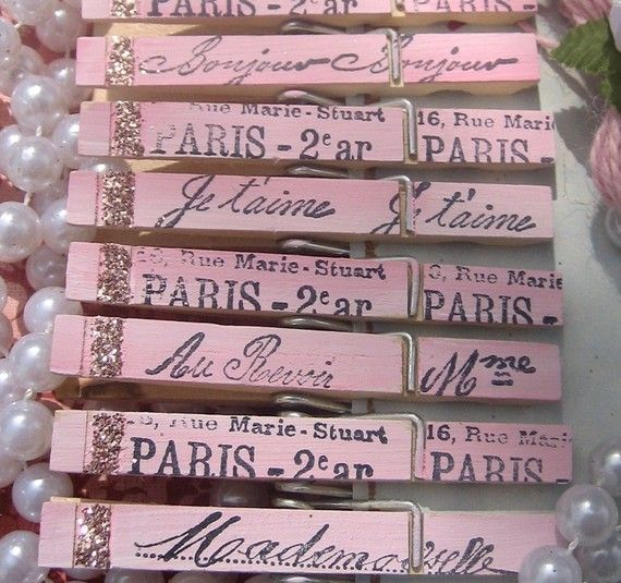 French Script ClothesPins with a touch of glitter glam oh so Paris Apartment oh so pretty in pink. Not sure what I'd use these for, but they are so cute!