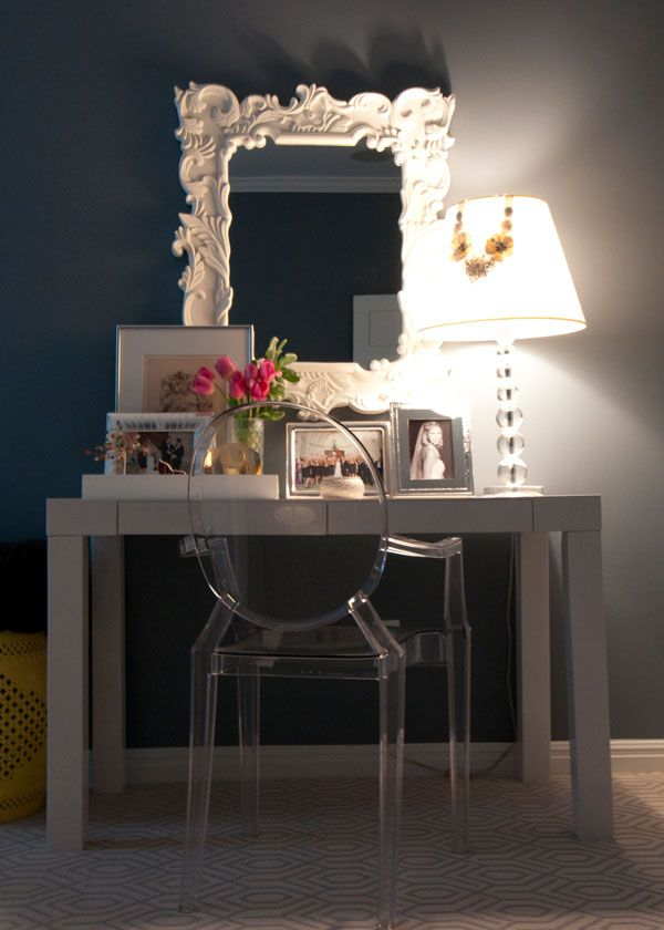 Loving the white desk with the clear plastic chair and dark on the wall. West Elm