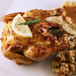 Cornish Game Hens with Garlic and Rosemary 4 Cornish game hens  salt and pepper to taste  1 lemon, quartered  4 sprigs fresh rosemary  3 tablespoons olive oil  24 cloves garlic  1/3 cup white wine  1/3 cup low-sodium chicken broth  4 sprigs fresh rosemary, for garnish