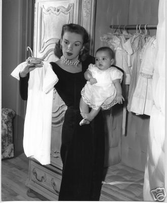 Judy Garland & Liza Minnelli; this is what I used to look like when the boys were babies picking out an outfit for them