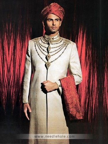 #Jamawar #reception #sherwani for men, embellished collar, neck, front and sleeves in beige color http://www.needlehole.com/jamawar-reception-sherwani-for-men-in-beige-color.html Aijaz aslam #reception sherwani and #sherwani suits for men. Pakistani wedding sherwani collection and indian men's sherwani suits collection by Aijaz aslam men's stores usa