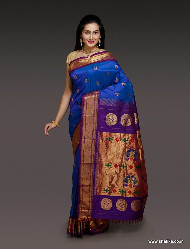 This Aniha Blue Paithani Silk Saree is woven in pure silk threads combining modernity and tradition together. Typical paithani art work on the Pallu with more designs is just the right choice for any occasion. This paithani silk saree is a traditional form of art blended with modernity that could brighten up your day and wardrobe.