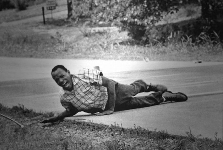 This devastating image shows civil rights activist James Meredith moments after he was shot on June 6, 1966 while leading a civil rights march. Said march aimed to encourage African Americans to exercise their voting rights and this image shows him pulling himself across the Highway in visible pain. Right after being treated, he completed the march from Memphis to Jackson.