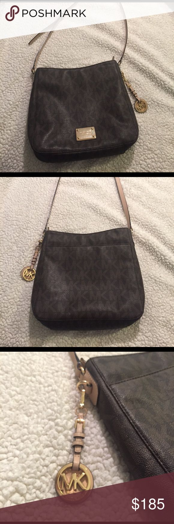 """Authentic Michael Kors Jet Set Large Crossbody Bag Authentic worn twice Micheal Kors """"Jet Set Large Travel Signature Cross-body Handbag. Measurements: 10'' x 10'"""" holds a lot and is great for travel. One outside button pocket. Adjustable over the shoulder leather straps. 4 inside compartments. PERFECT condition. Comment questions and interests❗️ Michael Kors Bags Crossbody Bags"""