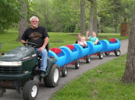 How much fun can the kids have being pulled around behind the Tractor or a Quad Bike.  You will love to make this Train that's made from Plastic Barrels!