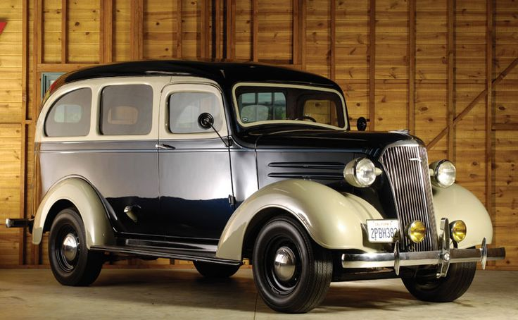 1938 Chevrolet Suburban.  Now why can't they make it look like this again? What great style would be going back down main street.
