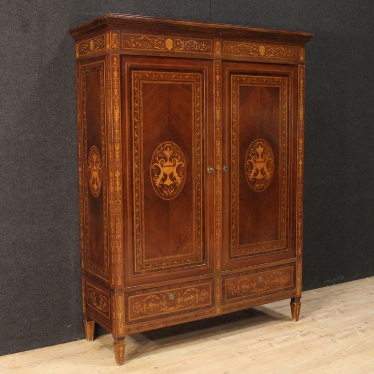 2500€ Italian inlaid wardrobe with two doors with mirrors in Louis XVI style. Visit our website www.parino.it #antiques #antiquariato #furniture #inlay #antiquities #antiquario #armoire #wardrobe #armadio #golden #gold #decorative #interiordesign #homedecoration #antiqueshop #antiquestore
