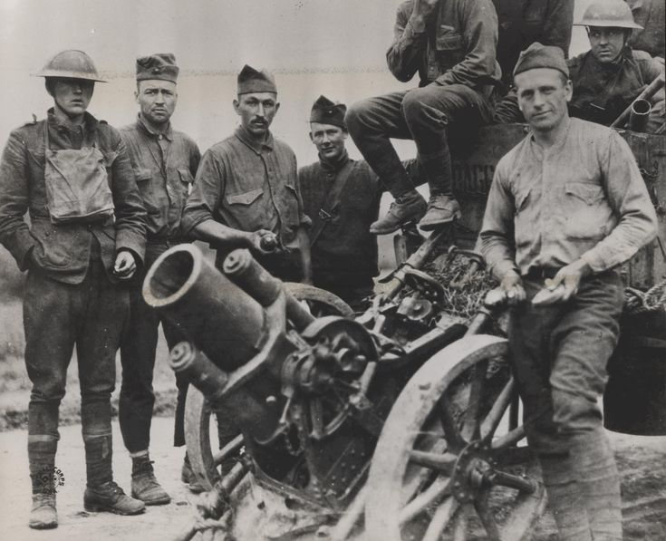 American Marines of the 2nd Battalion, 5th Regiment posing with a German minenwerfer captured during the Battle of Belleau Wood, 1918.