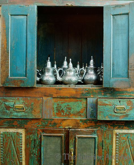 In the dining room a collection of silver teapots gleams against the  emerald green doors of - 200 Best V I N T A G E VIGNETTES Images On Pinterest