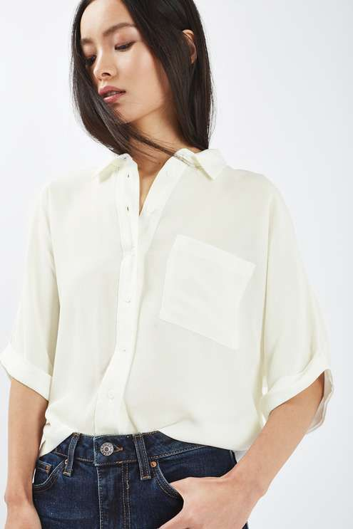 Embody smart-casual in this roll up shirt in white. With short sleeves, it's perfect for layering under a thick jacket and tucking into high waist jeans. Complete with a collar and button-down placket. #Topshop