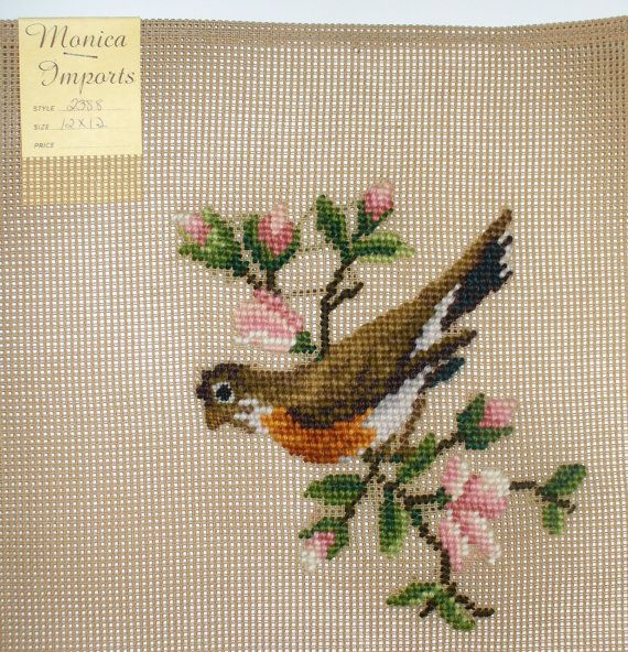 Bird lovers wall art or gift idea. 12 x 12 inch reworked needlepoint canvas by Monica Imports, still has original tag. A beautiful American Robin on a sprig of pink blossoms. All you need to do is stitch in your favorite background color and it is ready to hang or make into a pillow.  I do have more of these if you want more than one let me know.