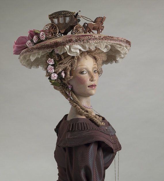 Woman in Hat     HISTORY: This doll was shown once at the Muscatine Art Museum in 2004 in Muscatine, Iowa. Nancy Wiley then took some time off from dollmaking for a few years and the piece was not shown again. this photograph of the doll was chosen to be on the NIADA poster in 2008 and is now available for sale to support this wonderful organization