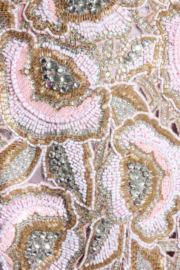 Detail of the embroidery on a 1983 Valentino evening dress.