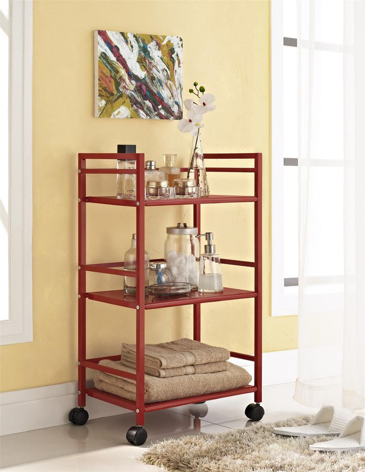 From the living room to the bathroom to the kitchen and beyond, the Ameriwood Home Marshall 3 Shelf Metal Rolling Utility Cart is a great addition to your home. Featuring a minimalistic style, the cart has 3 large shelves. Each shelf has 3 wraparound bars and can hold up to 20 lbs. Easily roll the cart from room to room on the 4 casters, 2 of which lock into place. Thanks to the red powder-coated metal finish, it will look great with any color scheme. Assembly is required, and the final…