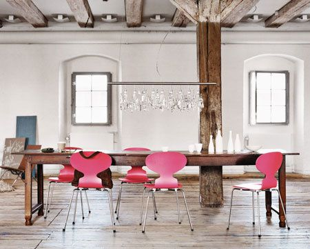 combination of mid-century modern chairs with rustic table and glam lighting