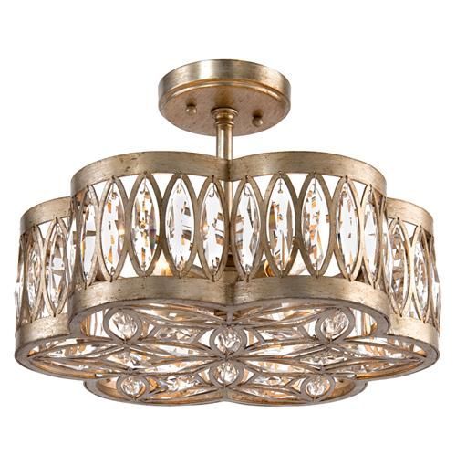 A fabulous, faceted fixture glistens from six lights encased in crystal and an antique silver curved frame. The shimmering round canopy creates a semi-flush mount with your ceiling, extending the grand chandelier upward, making a beautiful, bold statement of glamour.