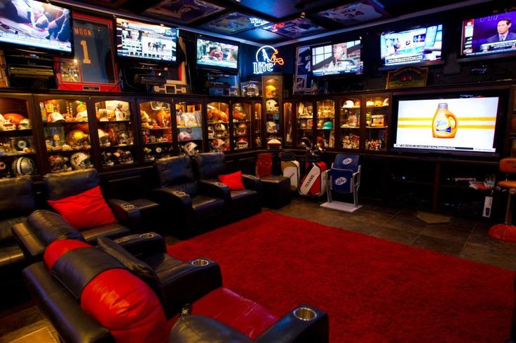 Blake Barnes, a Texans fan, has created his man cave that can seat about 50 people with multiple tel