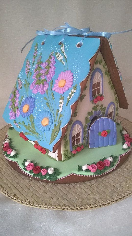 GINGERBREAD HOUSE~Spring flower with blue roof gingerbread house.