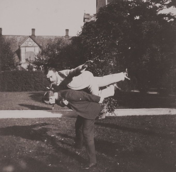 Tsar Nicolas II goofing around with his friend. are they trying to plank??? 1899