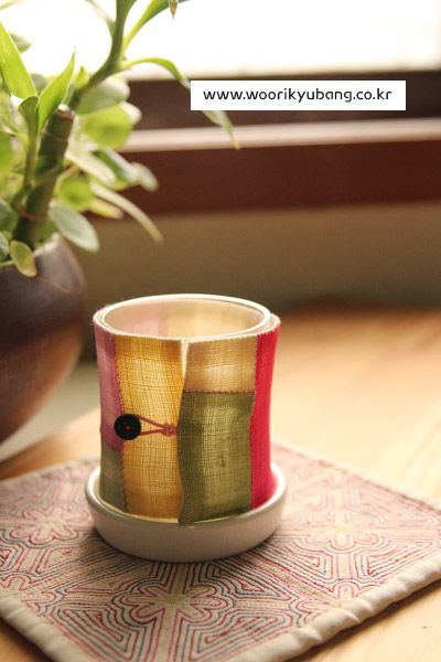 A little pojagi jacket for a candle holder glass! (Could put on a plant pot or vase, too, but with much less translucency) From a lovely Korean craft blog / fabric shop -- Google translate helps a little. 분위기 있는 캔들홀더예요. : 네이버 블로그