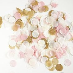 - Confetti is 1 inch diameter in size - total weight is 50 grams of confetti - 50 grams of confetti is roughly 7-8 handfuls of confetti once separated - Made from premium tissue paper - *To separate s