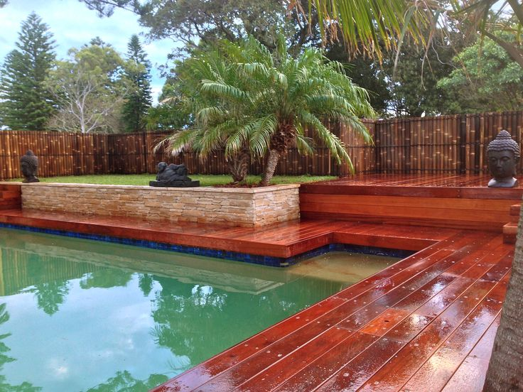 Balinese pool area, landscape design, jarrah decking, bamboo screen, stone cladding