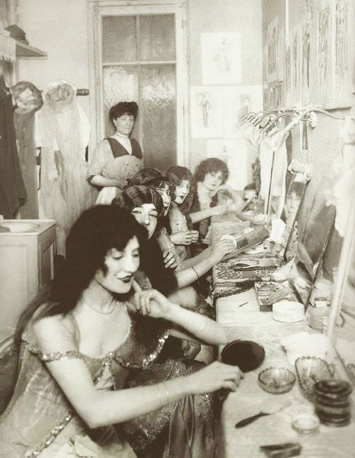 There is no such thing as too much makeup. Inside a dressing room at the Moulin Rouge, 1924