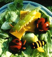 ladybug - cherry tomatoes, raisins, carrots bee - cheddar cheese, dates, carrots inch worm - green gapes, swiss cheese, carrots