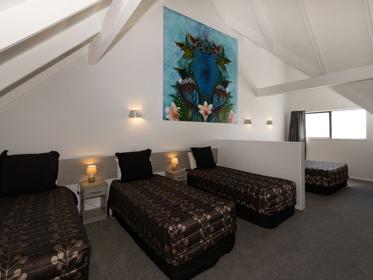 All Family Mezzanine rooms have a Queen bed upstairs.