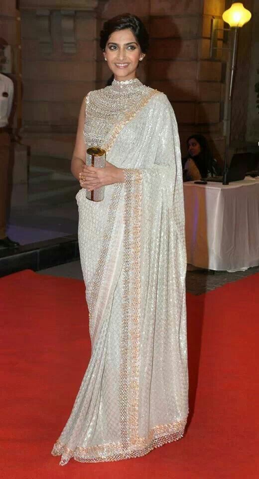 Sonam Kapoor wearing a white sari with detailed neck line...