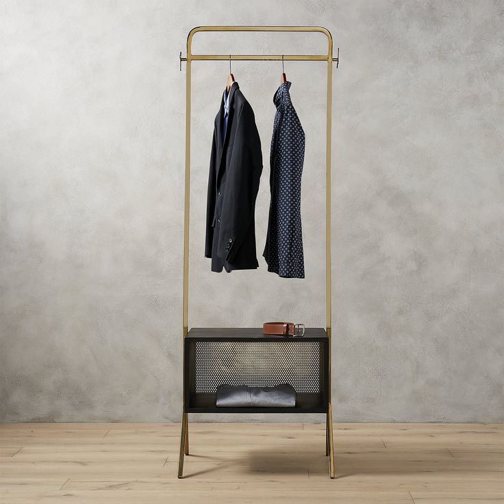 Shop valet clothes stand.   Ideal in the entry, guest room, or anywhere you need a little extra storage, handmade metal and mango wood valet transforms any space into an impromptu closet.