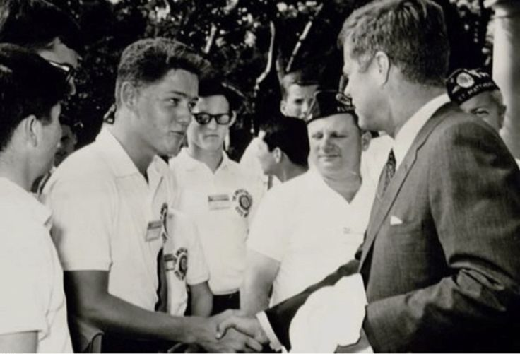 A young Bill Clinton shakes hands with John F. Kennedy, then the sitting president. The photo was taken in 1962, a year before Kennedy was assassinated. Clinton already looks very Clinton-like.