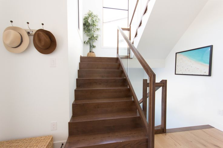 This staircase features custom treads with no overhanging bullnose which gives it a clean and modernized look. The handrail was also custom made rectangular to give a sleeker look then our traditional square handrail.