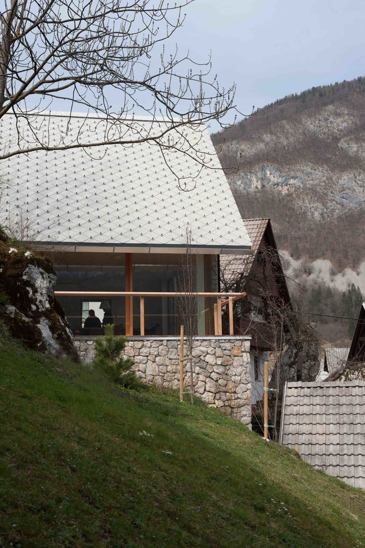 The House in the protected Alpine village of Stara Fužina is located in the Triglav National Park and addresses the traditional environment with author's interpretation of characteristic local details. Standing elegant on a steep hillside the house, by...