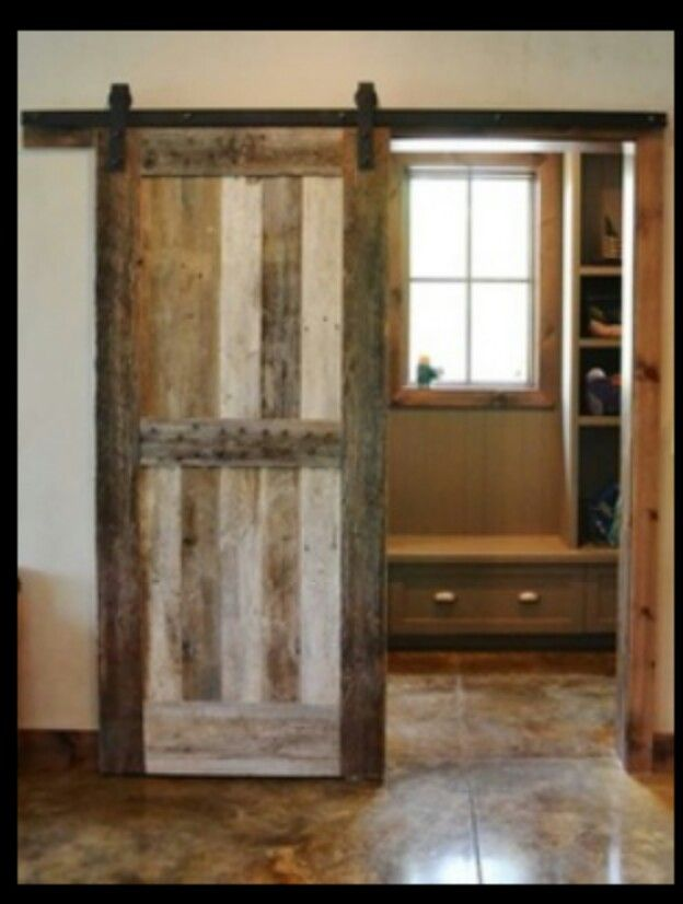 Sliding Barnwood Door To Separate The Mudroom/laundry Room From The Rest Of  The Home, Custom Made By Burchette. Stained Concrete Flooring With Sawn  Grooves.
