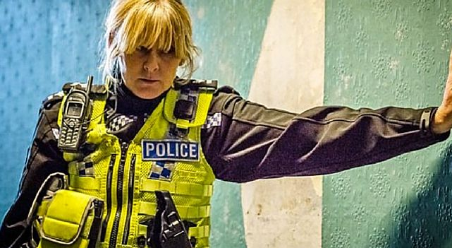 Happy Valley TV show follows Catherine Cawood (Sarah Lancashire) a tough as nails police sergeant in the West Yorkshire valley. Catherine's life at home is just as hectic as it is on the job. She is divorced, shares a house with her recovering alcoholic/heroin addict sister Claire (Siobhan Finneran). happy valley season 2, happy valley, happy valley tv show, happy valley tv series, best tv shows to watch. #HappyValley