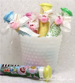 { HappyLittleArt }: The Candy Aisle...pastel Easter m&m's wrapped up in scrapbook paper. Attach a few ribbons and pink chickies and you're good to go!