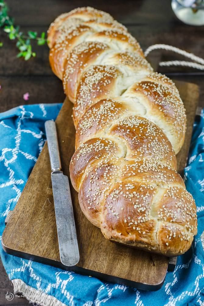 Easy challah bread recipe & tutorial with photos! Anyone can make this satisfying braided loaf enriched w/ eggs and topped with sesame seeds. Keeps well!
