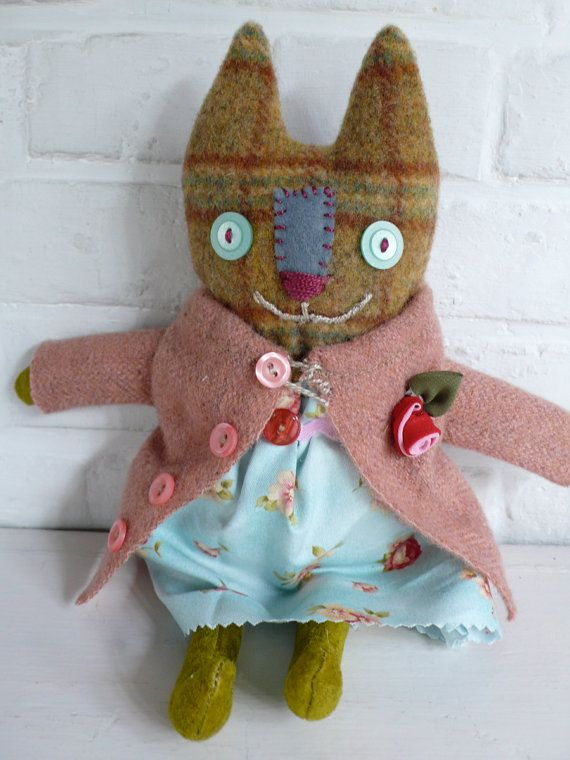 Nadia a primitive cloth cat doll by pussman on etsy:  http://www.etsy.com/listing/93901073/nadia-a-primitive-cloth-cat-doll