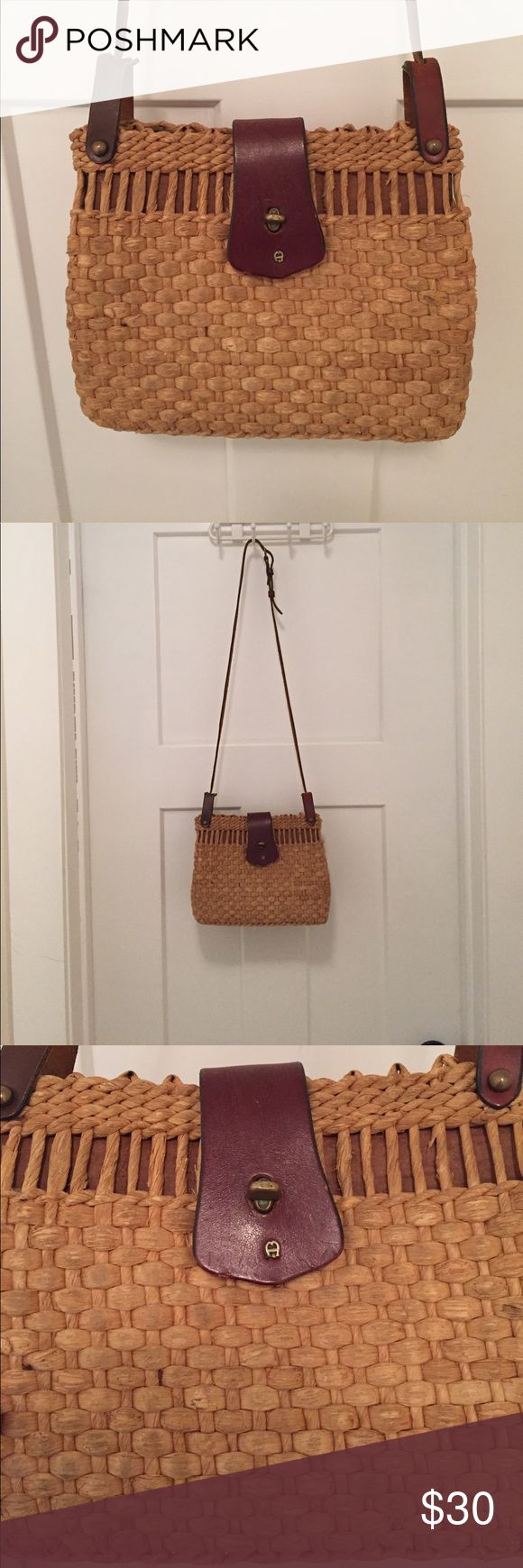 Leather and straw vintage handbag Great condition straw handbag with leather trim. By eitienne aigner. Has adjustable leather strap with a buckle. Etienne Aigner Bags