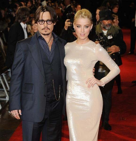 Romance rumor du jour: Johnny Depp once again cozying up to Amber Heard?
