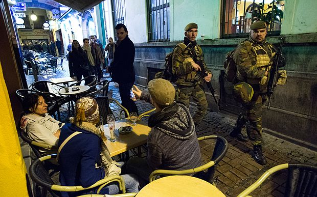 Armed Police and military forces patrol the streets of Central Brussels