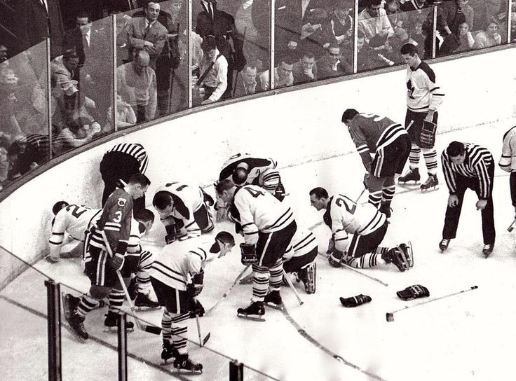 Blackhawks and Leafs looking for contact lens  (1962)