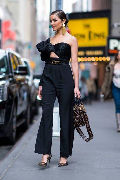 0964c48977d Olivia Culpo is seen wearing a Jacquemus coat Johanna Ortiz jumpsuit ...